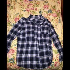 A long sleeve fleece button up shirt, worn once